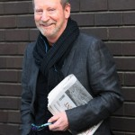 Bill Paterson, who seems to have stolen Tim's newspaper...
